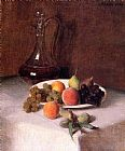 A Carafe of Wine and Plate of Fruit on a White Tablecloth
