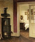 Carl Vilhelm Holsoe - An Interior with a Stove and a View into a Dining Room