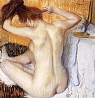Edgar Degas Famous Paintings - Woman Combing Her Hair